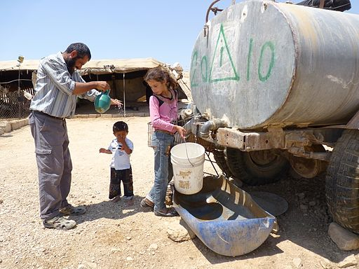 Village of a-Duqaiqah, South Hebron Hills, not hooked up to water grid; villagers purchase water from water-trucks, paying 4 times as much as the average water tariff for private use in Israel. By Nasser Nawaj'ah, B'Tselem