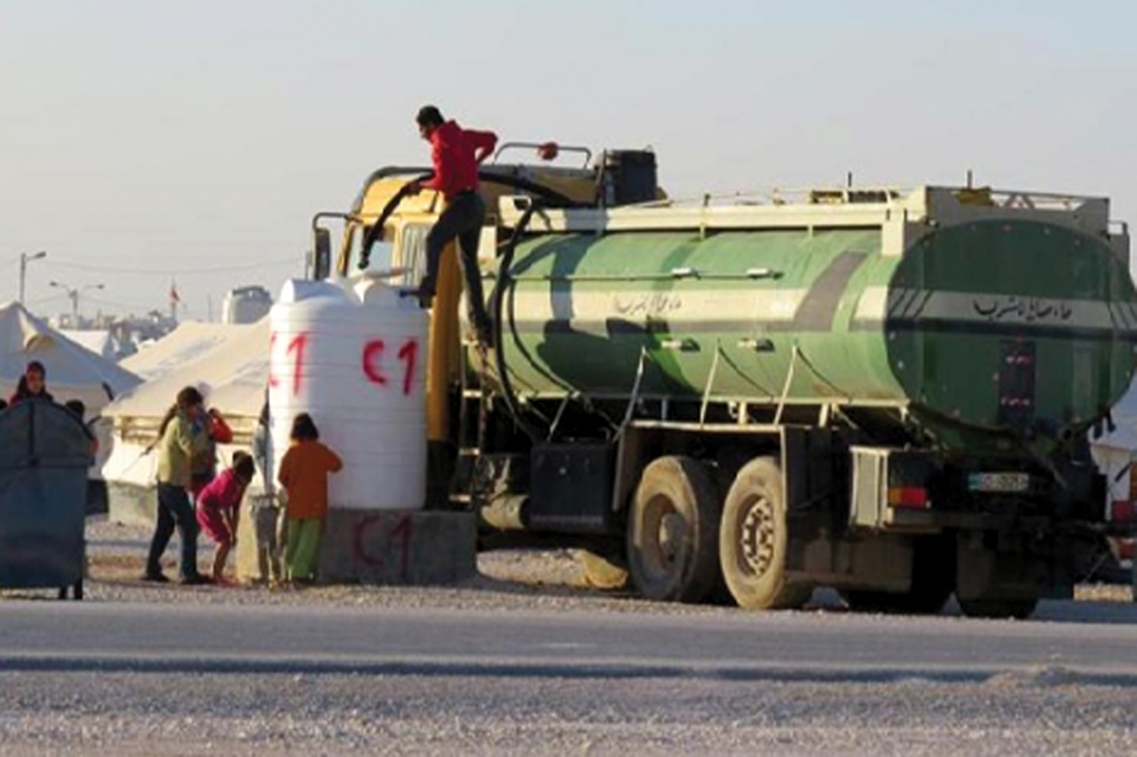 Truck delivering water at Zaatari camp (source: Ministry of Water and Irrigation, Jordan)