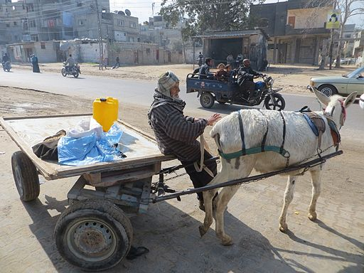 Taking the water container home- Gaza. By Muhammad Sabah, B'Tselem