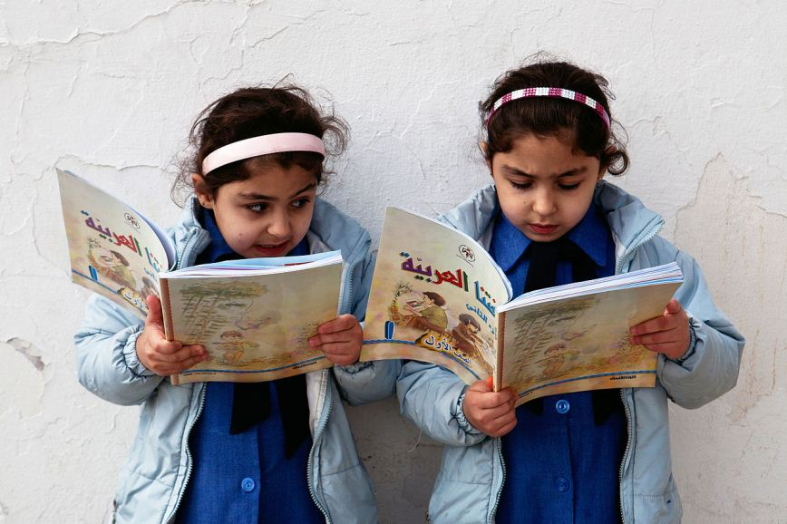 Young Girls Reading at Government Primary School in Amman Photo: Tanya Habjouqa.