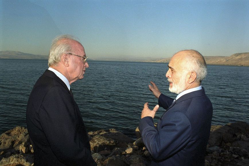 Israeli Prime Minister Yitzhak Rabin and King Hussein of Jordan confer at Lake Tiberias after signing the Israel-Jordan peace treaty in 1994. Photo: Saar Yaacov.